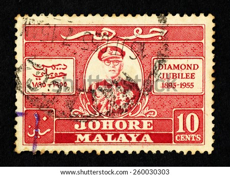 MALAYA - CIRCA 1955: Red color postage stamp printed in Johore (Federation of Malaya) with illustrative image of Sultan Ibrahim II to commemorate the Sultanate Diamond Jubilee. - stock photo