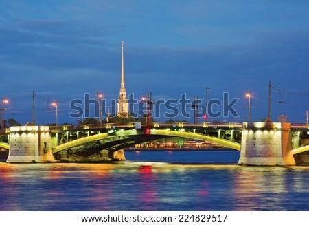 Malaya Neva river. Birzhevoy Bridge (Exchange Bridge) and the spire of Peter and Paul Cathedral. St.-Petersburg, Russia - stock photo