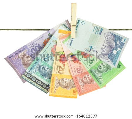 Malaysia Bank Notes money hanging on a clothes line - stock photo