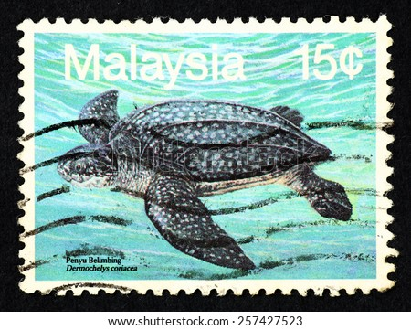 MALAYSIA - CIRCA 1990: Blue color postage stamp printed in Malaysia with image of a leatherback sea turtle (Dermochelys coriacea) for the Marine Life series III. - stock photo