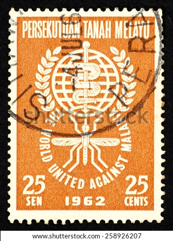 MALAYSIA - CIRCA 1962: Orange color postage stamp printed in Malaysia with a Caduceus medical symbol to commemorate the world united against malaria. - stock photo