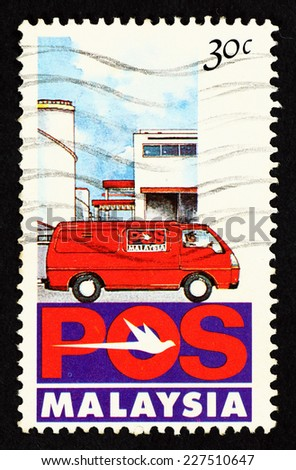 MALAYSIA - CIRCA 1992: Postage stamp printed in Malaysia with caricature image of Pos Malaysia postal delivery van. - stock photo