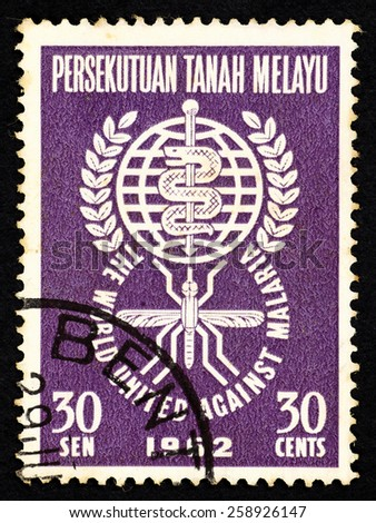 MALAYSIA - CIRCA 1962: Purple color postage stamp printed in Malaysia with a Caduceus medical symbol to commemorate the world united against malaria. - stock photo