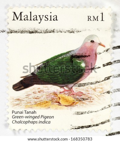 MALAYSIA - CIRCA 2012: Stamps printed in Malaysia with image of a Green wined Pigeon, circa 2012. - stock photo