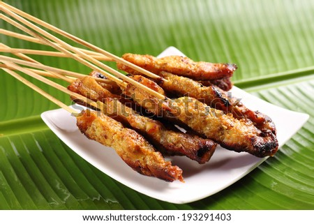 Malaysian chicken satay, one of famous local dishes. - stock photo