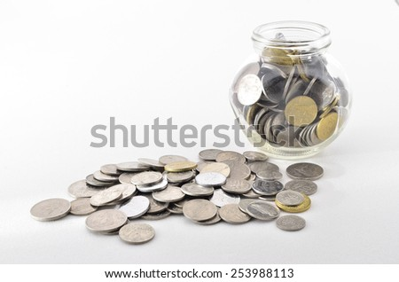Malaysian Coin in glass container. Shoot over white background. Focus on the important part. Shallow depth of field. - stock photo