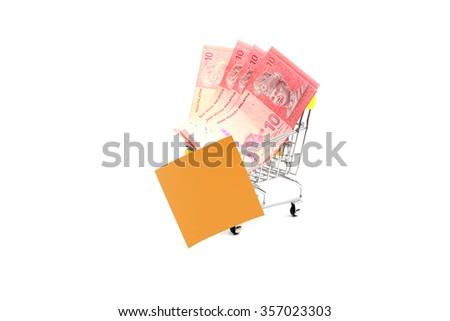 Malaysian currency. Ten ringgit in shopping trolleys and piece of memo paper on a white background. - stock photo