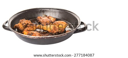 Malaysian dish of deep fried chicken in with black soy gravy in a saute pan - stock photo