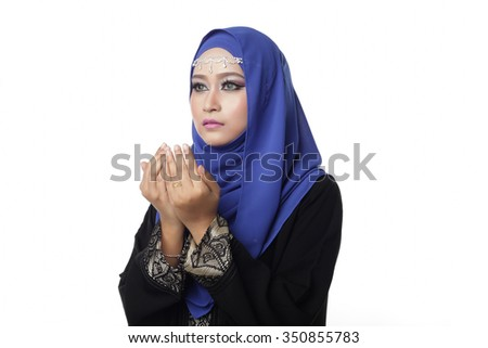 Malaysian malay woman praying isolated in white background - stock photo