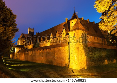 Malbork at night, Pomerania, Poland - stock photo