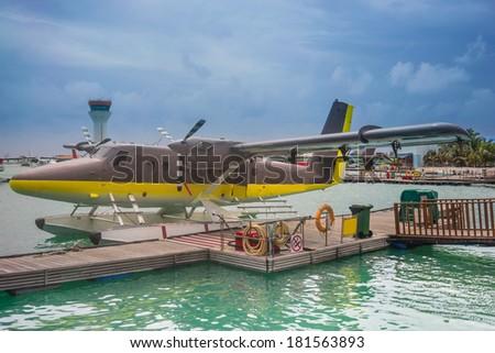 Maldives air taxi seaplane - stock photo