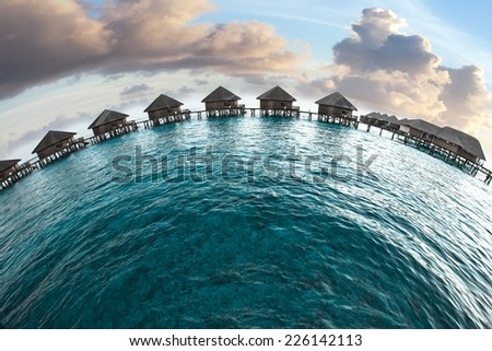Maldives. houses on piles on water - stock photo