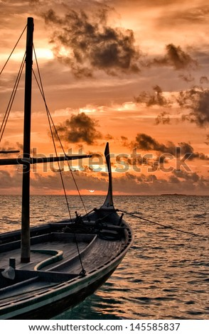 maldivian Dhoni in the Sunset - stock photo