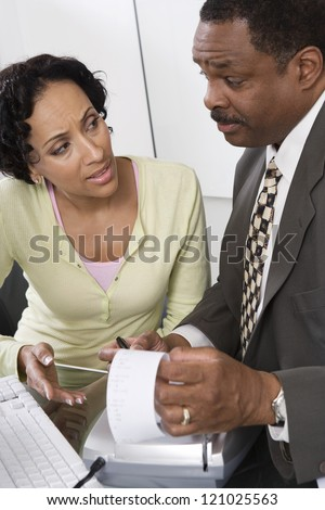 Male accountant with female client discussing at office - stock photo