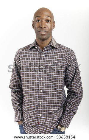 Male African American standing with hands in pockets wearing a check shirt - stock photo
