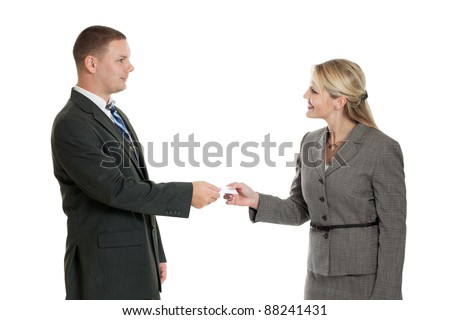 Male and female business people exchanging business card isolated on a white background - stock photo