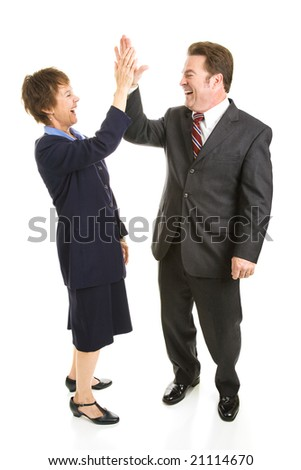 Male and female business people slapping each other high five.  Full body isolated on white. - stock photo