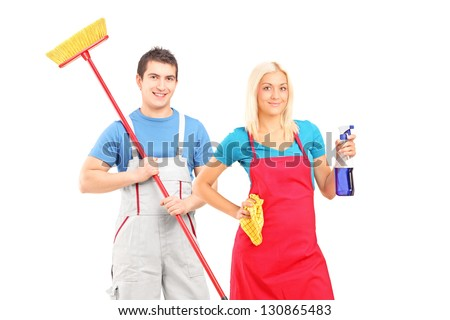 Male and female cleaners with cleaning supplies posing isolated on white background - stock photo