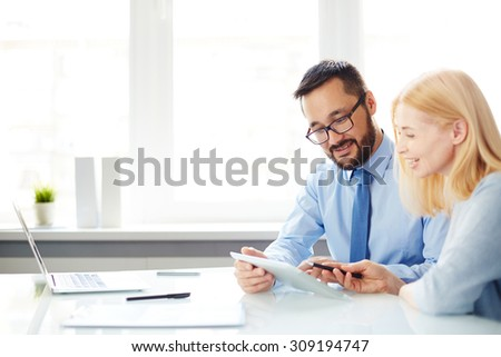 Male and female colleagues discussing plans - stock photo