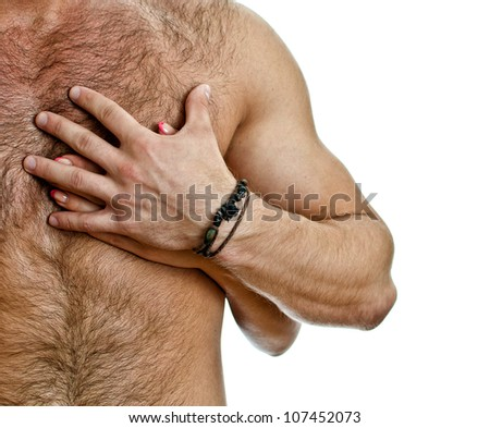 Male and female hand on the man's chest. Isolated on white. - stock photo