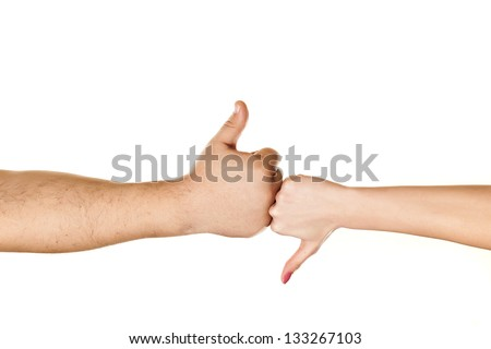 male and female hand showing thumbs like and dislike on white background - stock photo