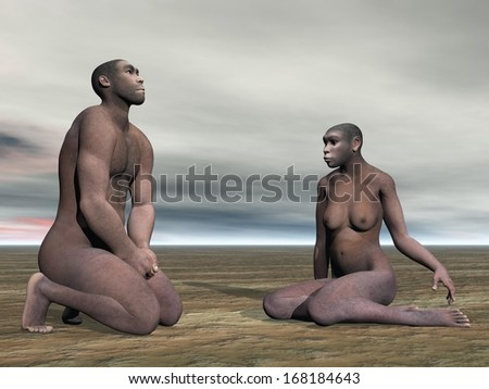 Male and female homo erectus bust sitting on the ground by grey cloudy day - stock photo