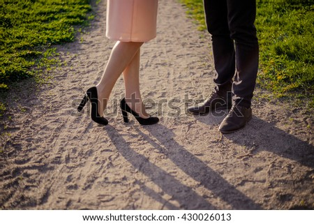 Male and female legs during a date. - stock photo