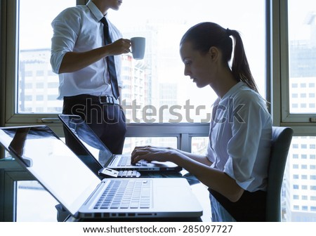 Male and female office workers. - stock photo