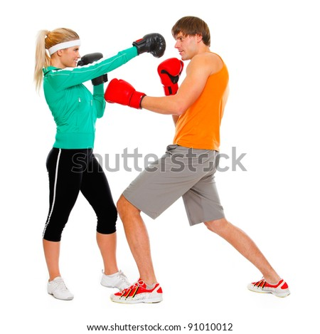 Male and female par in sportswear boxing isolated on white - stock photo