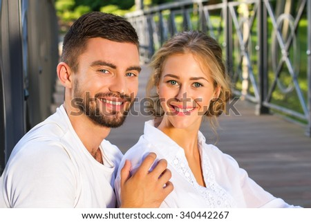Male and female smiling close-up.A young couple has a healthy clean face and a charming smile.Positive and attractive caucasian together.Enjoying every minute together. - stock photo