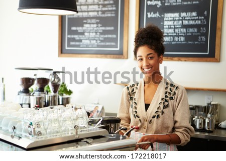Male And Female Staff In Coffee Shop - stock photo
