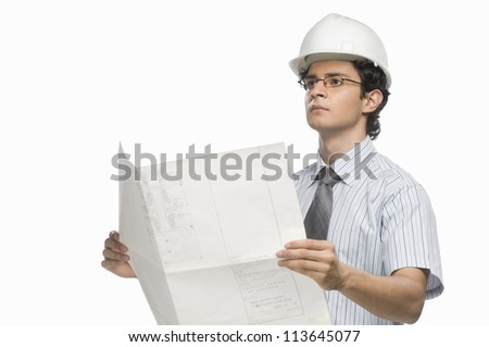 Male architect holding a blueprint - stock photo