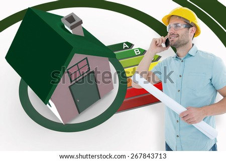 Male architect with blueprint talking on mobile phone against energy ratings growing from 3d house - stock photo