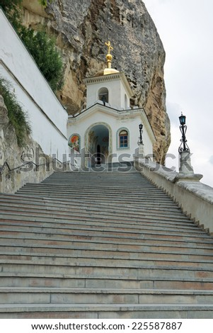 Male Assumption Monastery of the Caves. Unique Orthodox monastery dug into the rock. Bakhchisaray, republic of Crimea, Russia - stock photo