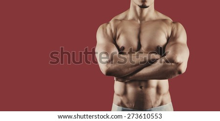 Male athlete. Bodybuilder isolated on the background - stock photo