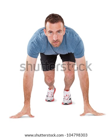 Male Athlete in runner starting stance - stock photo