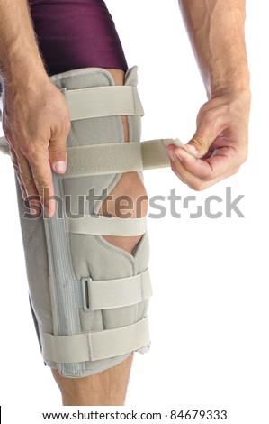 Male athlete wraps his leg with firm support - stock photo