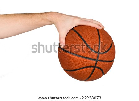 Male basketball player palming a ball, isolated on white - stock photo