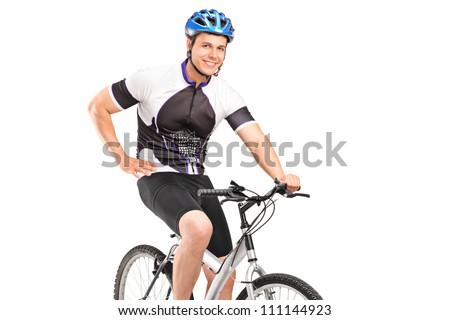 Male biker with helmet posing on a bike - stock photo
