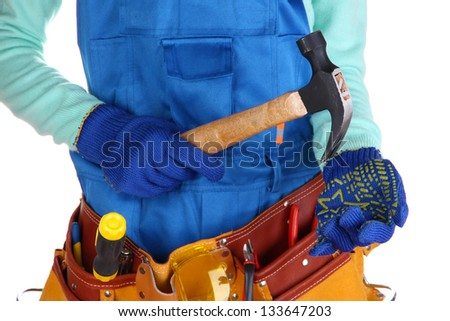 Male builder in blue overalls with gavel isolated on white - stock photo
