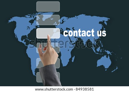 male business hand pushing on contact us button with world map background - stock photo