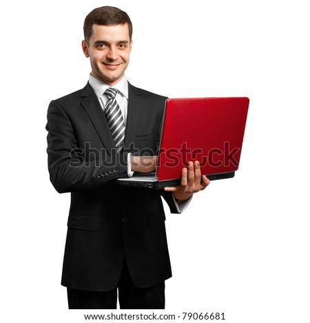 male businessman in suit with laptop in his hands, looking on camera - stock photo