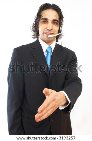 male call center operator on white background, ready to handshake - stock photo