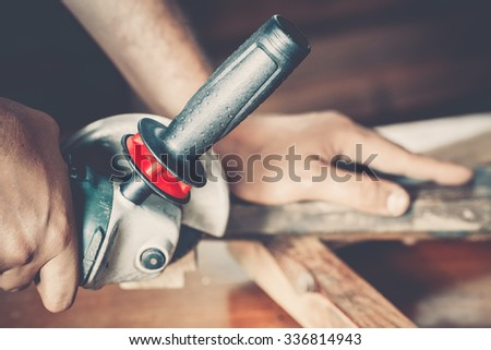 male carpenter at work close up - stock photo