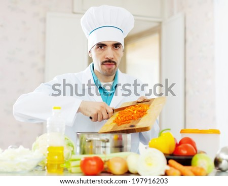 Male chef cooking veggy lunch - stock photo