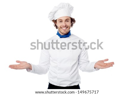 Male chef in uniform welcoming guests - stock photo