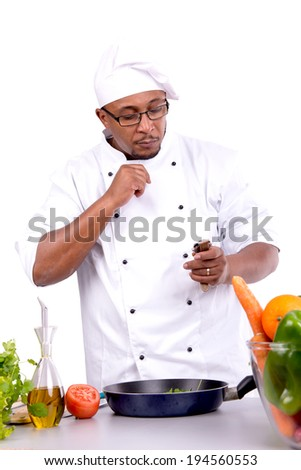 Male chef looking at the time, cooking - stock photo