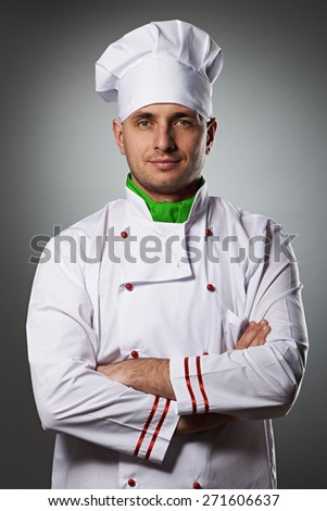 Male chef portrait against grey background - stock photo