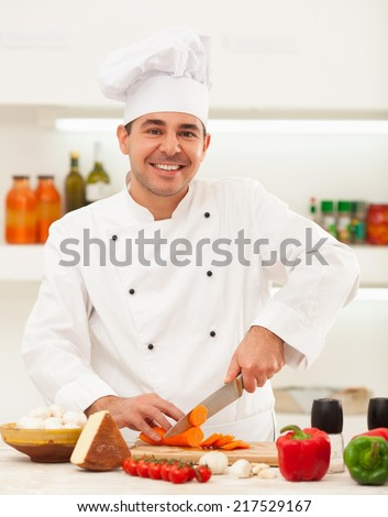 Male chef preparing vegetables for cooking. - stock photo