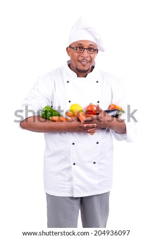 Male chef with fruits and vegetables isolated in white - stock photo